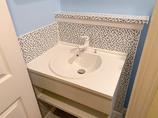 洗面リフォーム見た目と清掃性を両立させたタイル調の洗面台